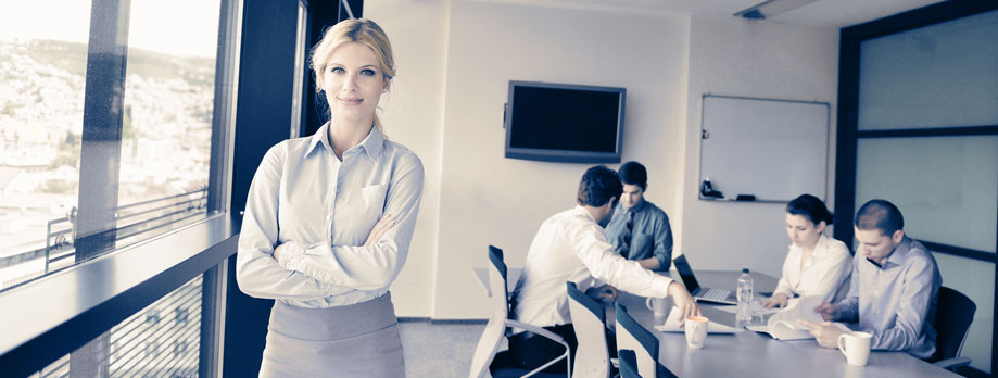 Photo of woman posing in a board room